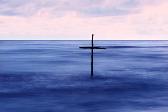wooden cross in Jordan River